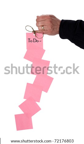 Hand with to-do list tied to finger with a string - stock photo