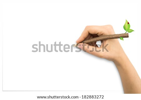 Hand with tree trunk pencil drawing and white sheet - stock photo