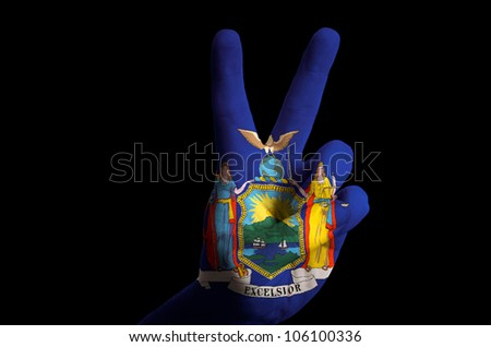 Hand with two finger up gesture in colored new york oklahoma state flag as symbol of winning,  - for tourism and touristic advertising, positive political, cultural, social management of country - stock photo