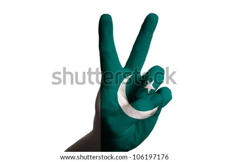 Hand with two finger up gesture in colored pakistan national flag as symbol of winning,  - for tourism and touristic advertising, positive political, cultural, social management of country - stock photo