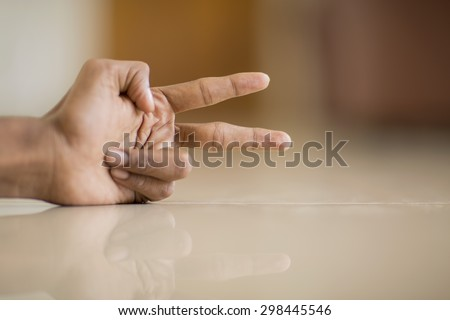 Hand with two fingers up in the peace or victory symbol. Also the sign for the letter V in sign language.  - stock photo