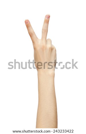 Hand with two fingers up in the peace or victory symbol. studio photo - stock photo