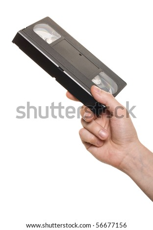 Hand with video cassette isolated over white - stock photo