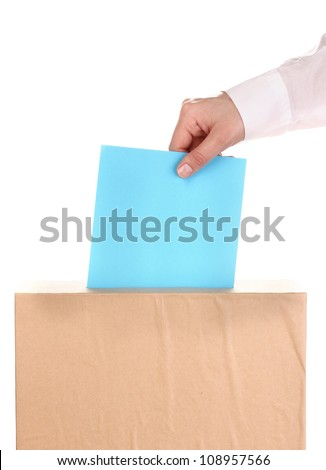 Hand with voting ballot and box isolated on white - stock photo