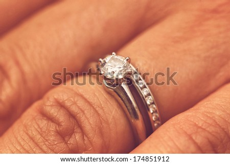 Hand with wedding rings - stock photo