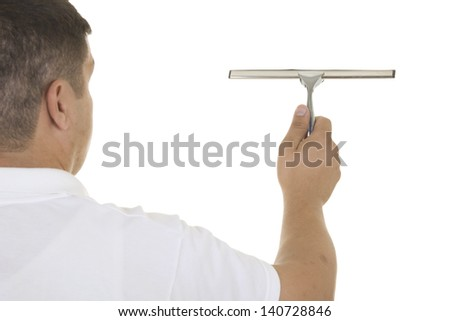 hand with window cleaning tool - stock photo