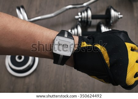 Hand with wrist watch shows the beginning of the training - stock photo