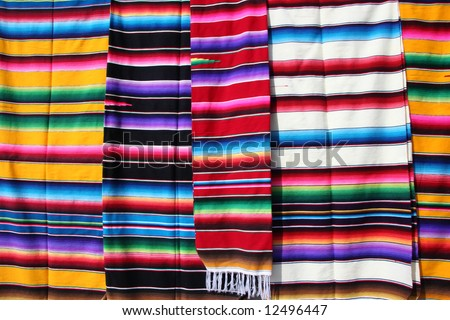 Hand woven clothes at the market in Guadalajara. Mexico - stock photo