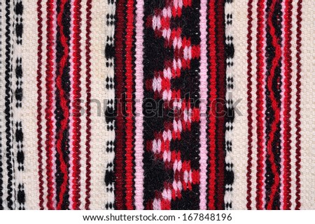 Hand woven patterned fabric for background - stock photo