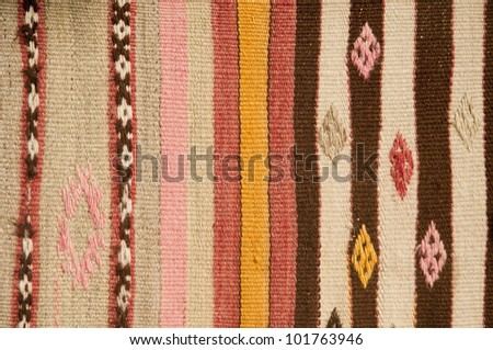 Hand woven Turkish rug with traditional geometric design - stock photo