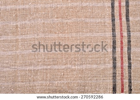 Hand woven woolen fabric, background - stock photo