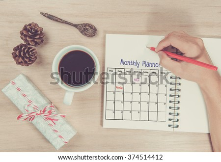 hand write Calender Planner on book. - stock photo