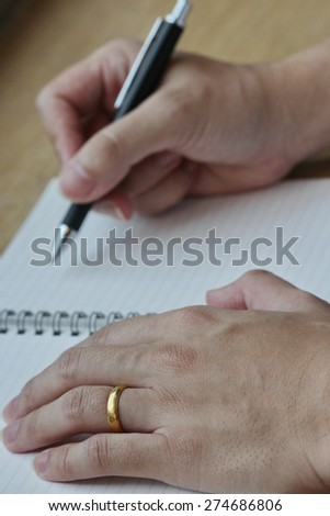 hand write on paper, dark - stock photo