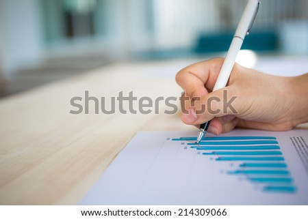 Hand write on Various financial charts on the table