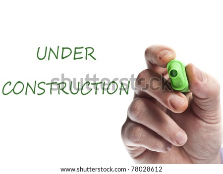Hand write with green marker Under construction - stock photo