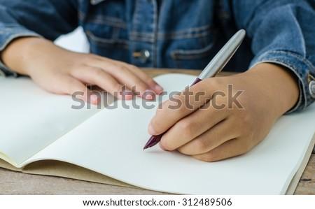 hand write with hand left - stock photo
