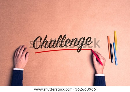 Hand writing a single word Challenge on paper - stock photo