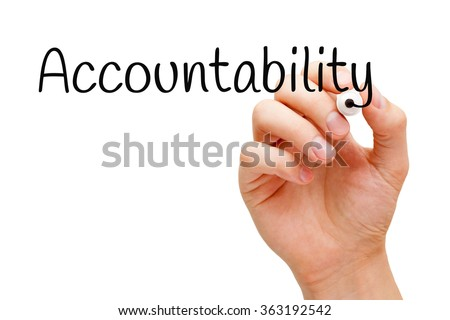 Hand writing Accountability with black marker on transparent wipe board. - stock photo