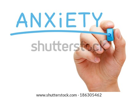 Hand writing Anxiety with blue marker on transparent wipe board. - stock photo