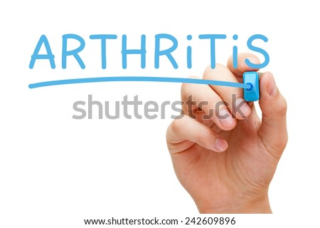 Hand writing Arthritis with blue marker on transparent wipe board isolated on white.
