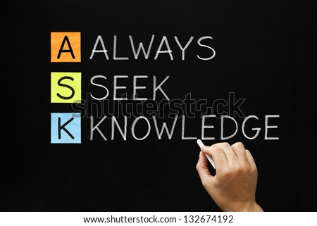 Hand writing  ASK - Always Seek Knowledge with white chalk on blackboard. - stock photo