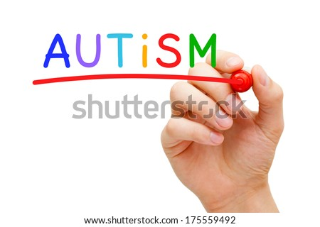 Hand writing Autism with marker on transparent wipe board. - stock photo