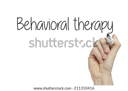 Hand writing behavioral therapy on a white board - stock photo