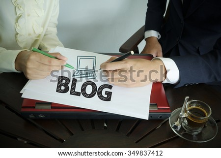 hand writing BLOG text with two business person , team work concept - stock photo