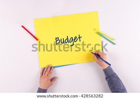 Hand writing Budget on yellow paper - stock photo