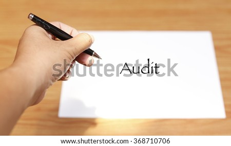 Hand writing Business Notes - audit .soft focus , selective focus - stock photo