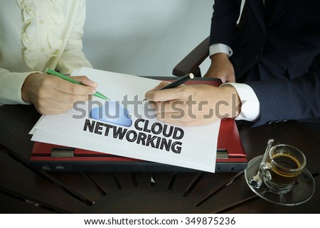 hand writing CLOUD NETWORKING text with two business person , business concept , business idea , team work concept - stock photo