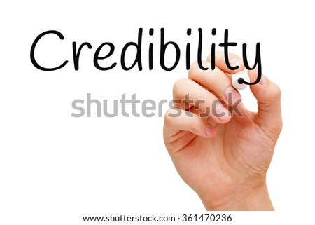Hand writing Credibility with black marker on transparent wipe board.