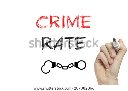 Hand writing crime rate on a white board - stock photo