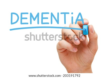 Hand writing Dementia with blue marker on transparent wipe board. - stock photo