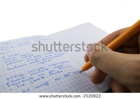 hand writing down apple pie recipe in notepad
