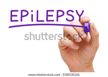 Hand writing Epilepsy with purple marker on transparent wipe board. - stock photo