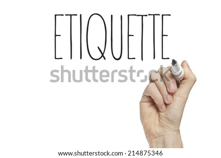 Hand writing etiquette on a white board - stock photo