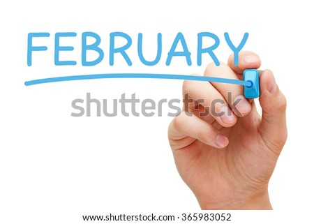 Hand writing February with blue marker on transparent wipe board. - stock photo