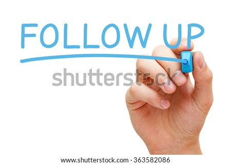 Hand writing Follow Up with blue marker on transparent wipe board. - stock photo