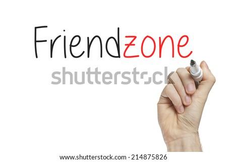 Hand writing friendzone on a white board - stock photo