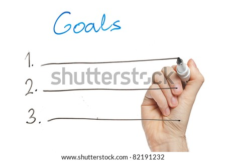hand writing goals on whiteboard