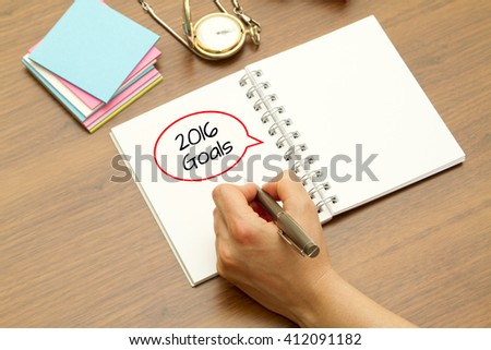 Hand writing 2016 GOALS word on a notebook with pen. - stock photo