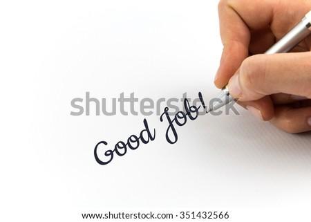 "Hand writing ""Good Job"" on white sheet of paper. - stock photo"