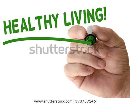 Hand writing healthy living with black marker on transparent wipe board