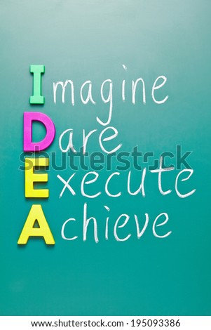Hand writing IDEA - Imagine Dare Execute Achieve on blackboard - stock photo