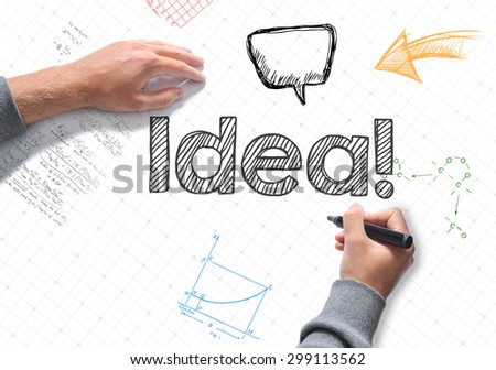 Hand writing Idea word on white sheet of paper