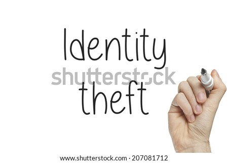 Hand writing identity theft on a white board - stock photo