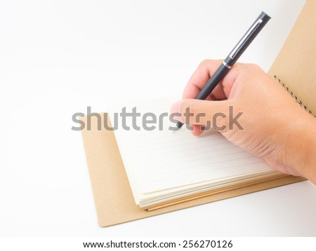 hand writing in notebook - stock photo