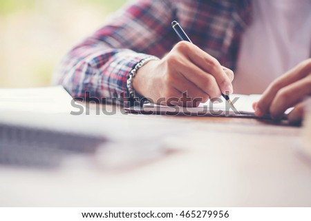Hand writing in notebook for background