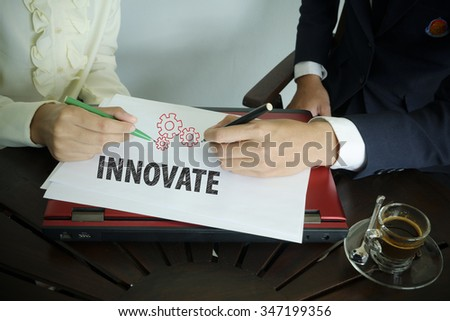 hand writing Innovate text with two business person , business concept  - stock photo